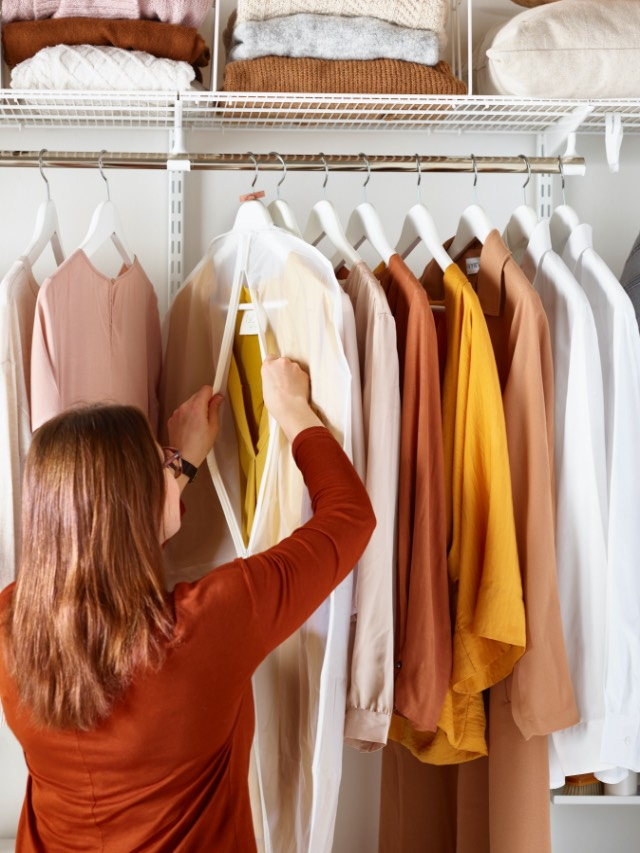 Woman sorting her clothes in her wardrobe