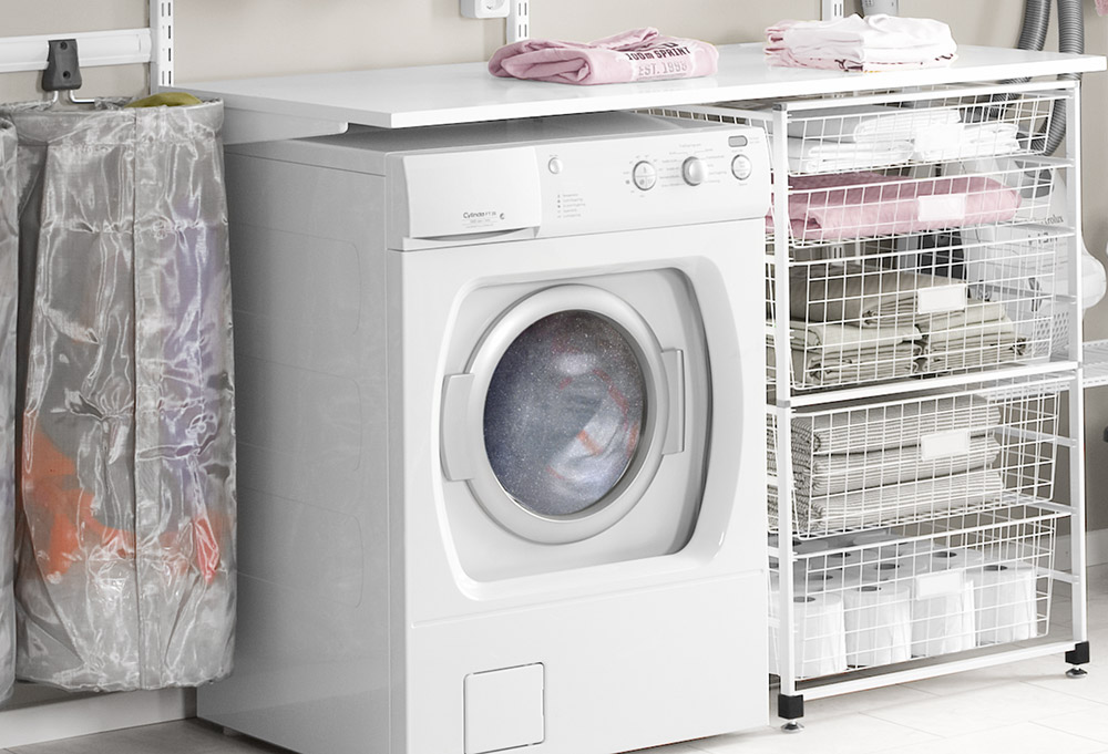 Mesh storage bag and drawer frame in laundry room