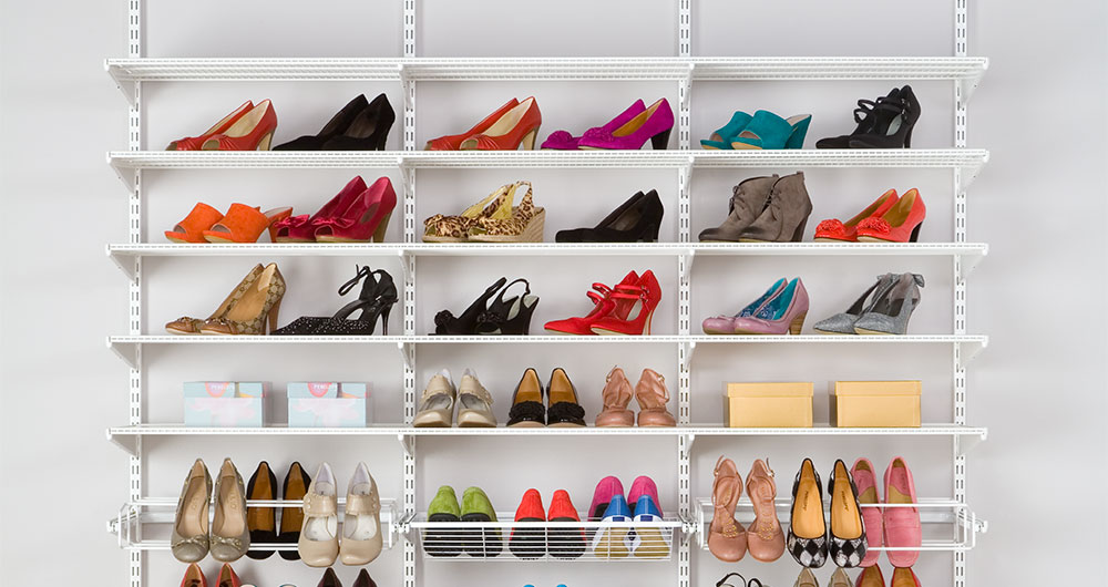Shoe shelves on the wall with room for lots of shoes