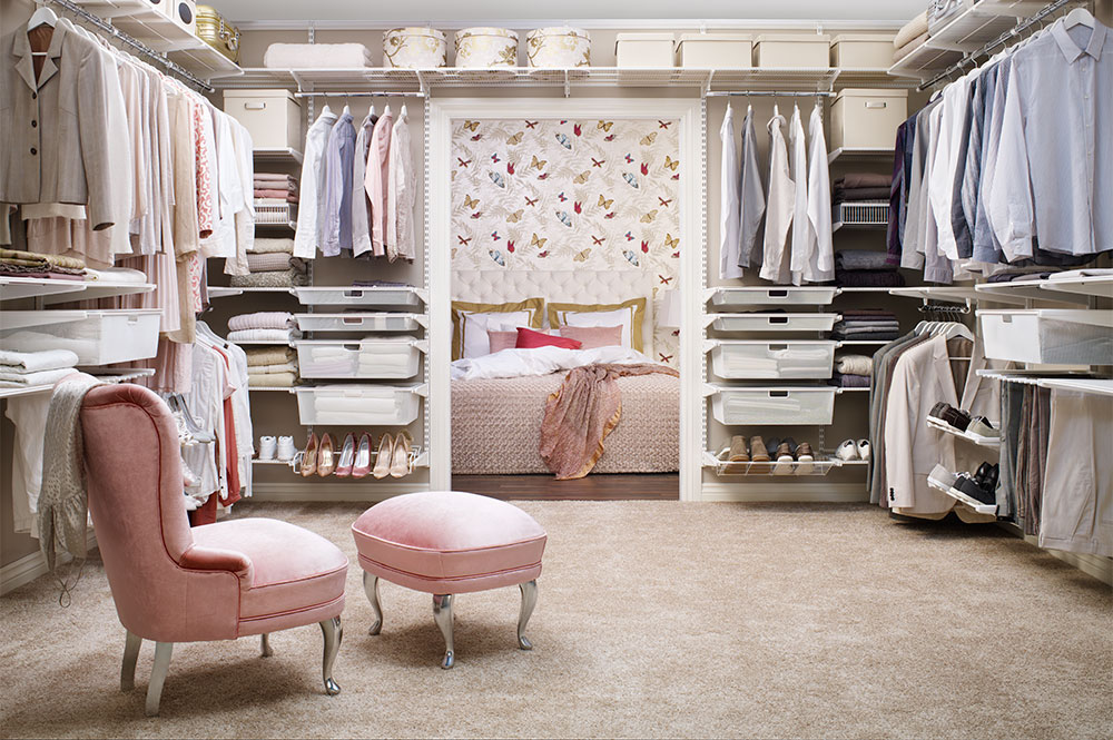 Walk-in closet with storage on all walls