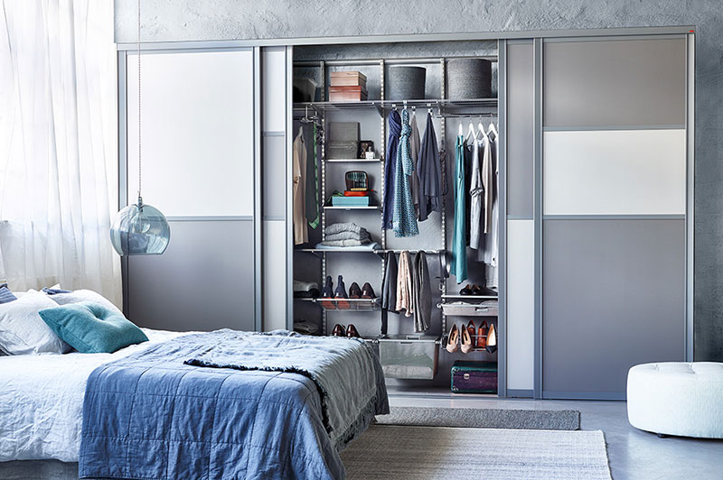 Wardrobe with sliding doors in a modern bedroom