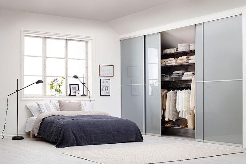 Sliding doors and wardrobe in a light bedroom