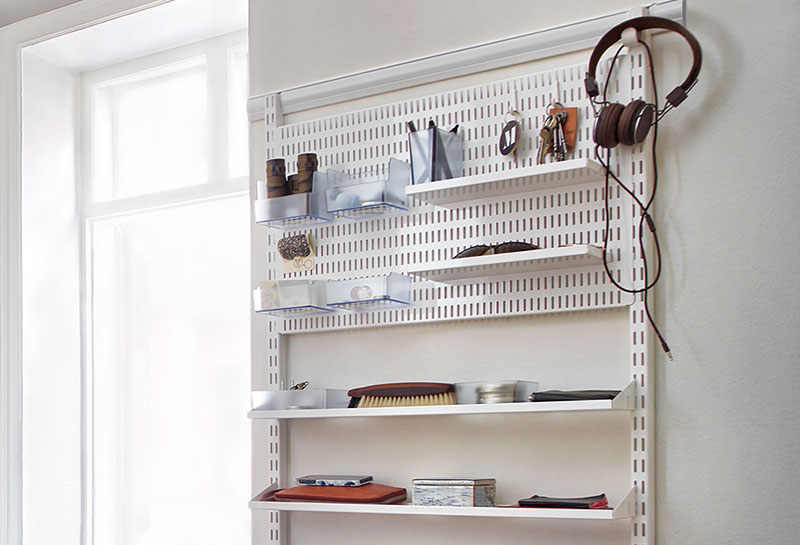 Storage on a wall with room for keys, mobile and other common items
