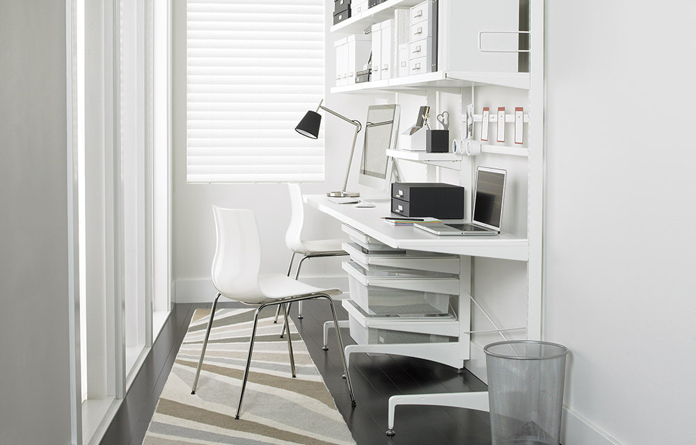 Compact work space with floor based storage