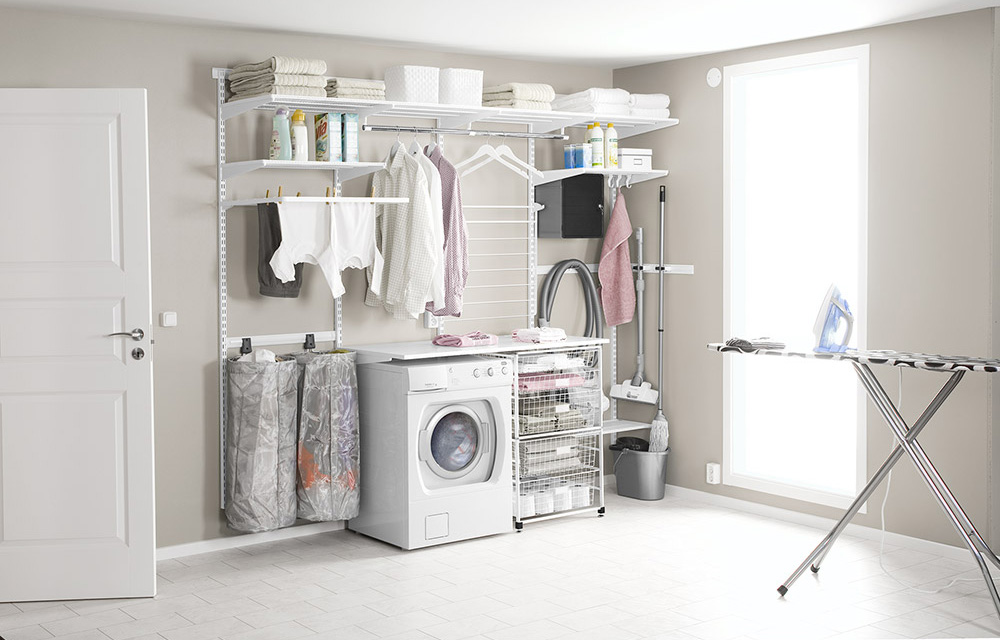 Laundry room with practical shelves, washing basket and clothes drier
